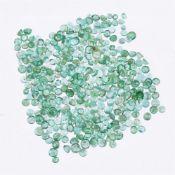 † A packet of circular cut emeralds