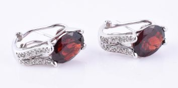 A pair of garnet and diamond ear clips