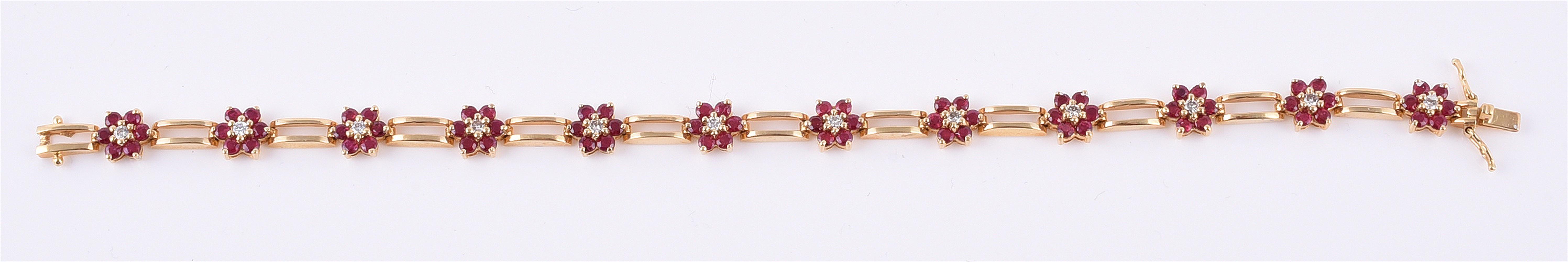 A ruby and diamond flowerhead cluster bracelet