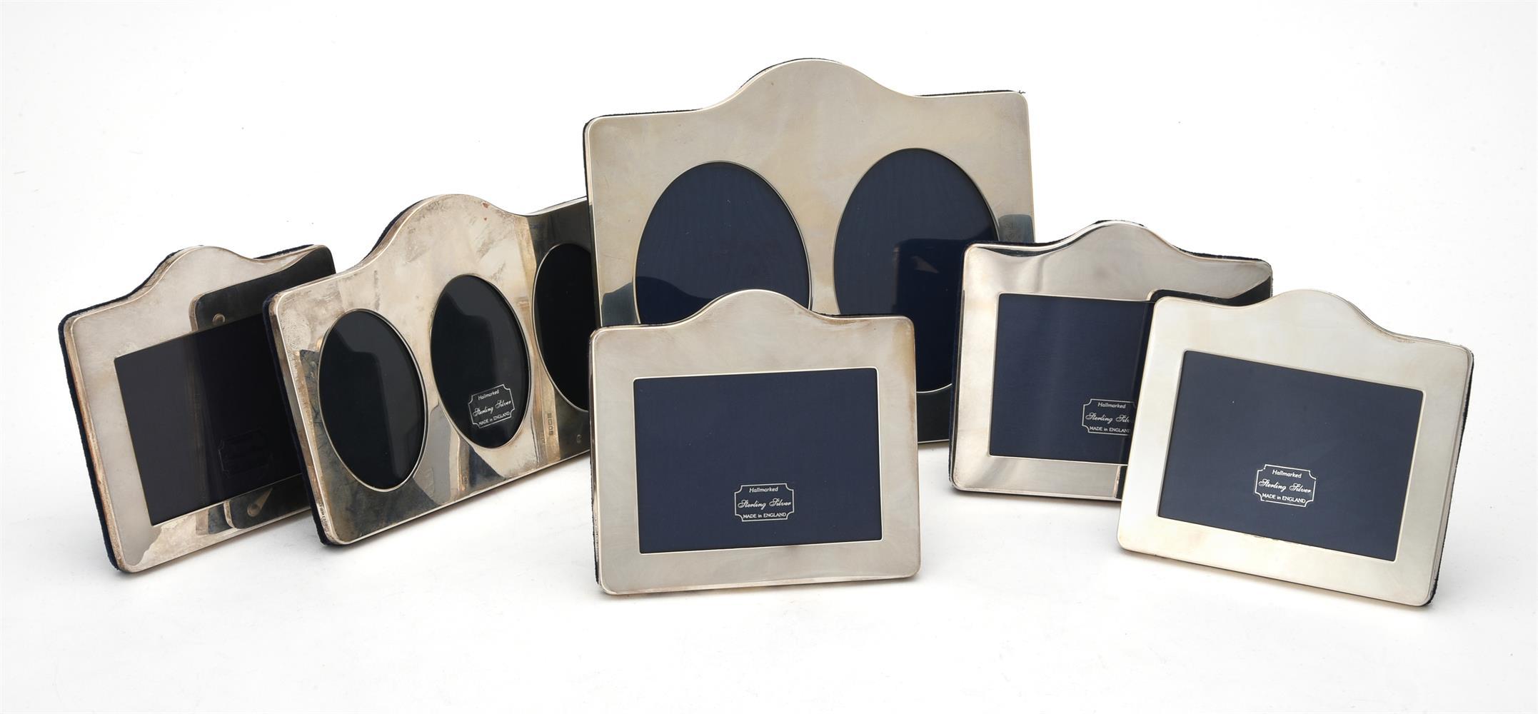 Six silver mounted shaped rectangular photo frames