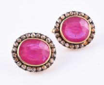 A pair of synthetic glass filled ruby and diamond ear clips