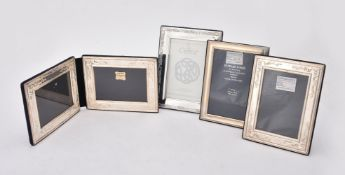 Four silver mounted photo frames