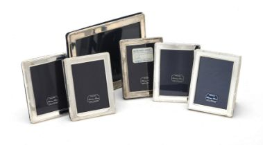 Six silver mounted rectangular photo frames