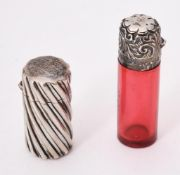 A Victorian silver cylindrical scent bottle by Sampson Morden
