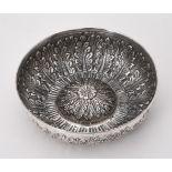 An Islamic silver coloured bowl