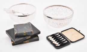 An Edwardian cut glass bowl with silver rim