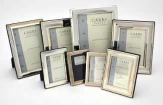 Eight silver mounted rectangular photo frames by Carr's of Sheffield Ltd.