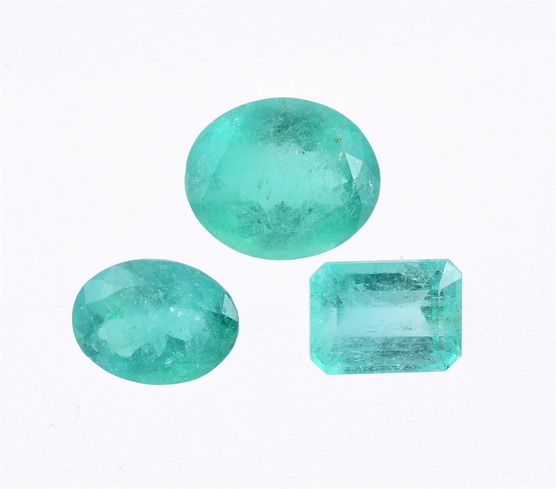 † Three unmounted emeralds