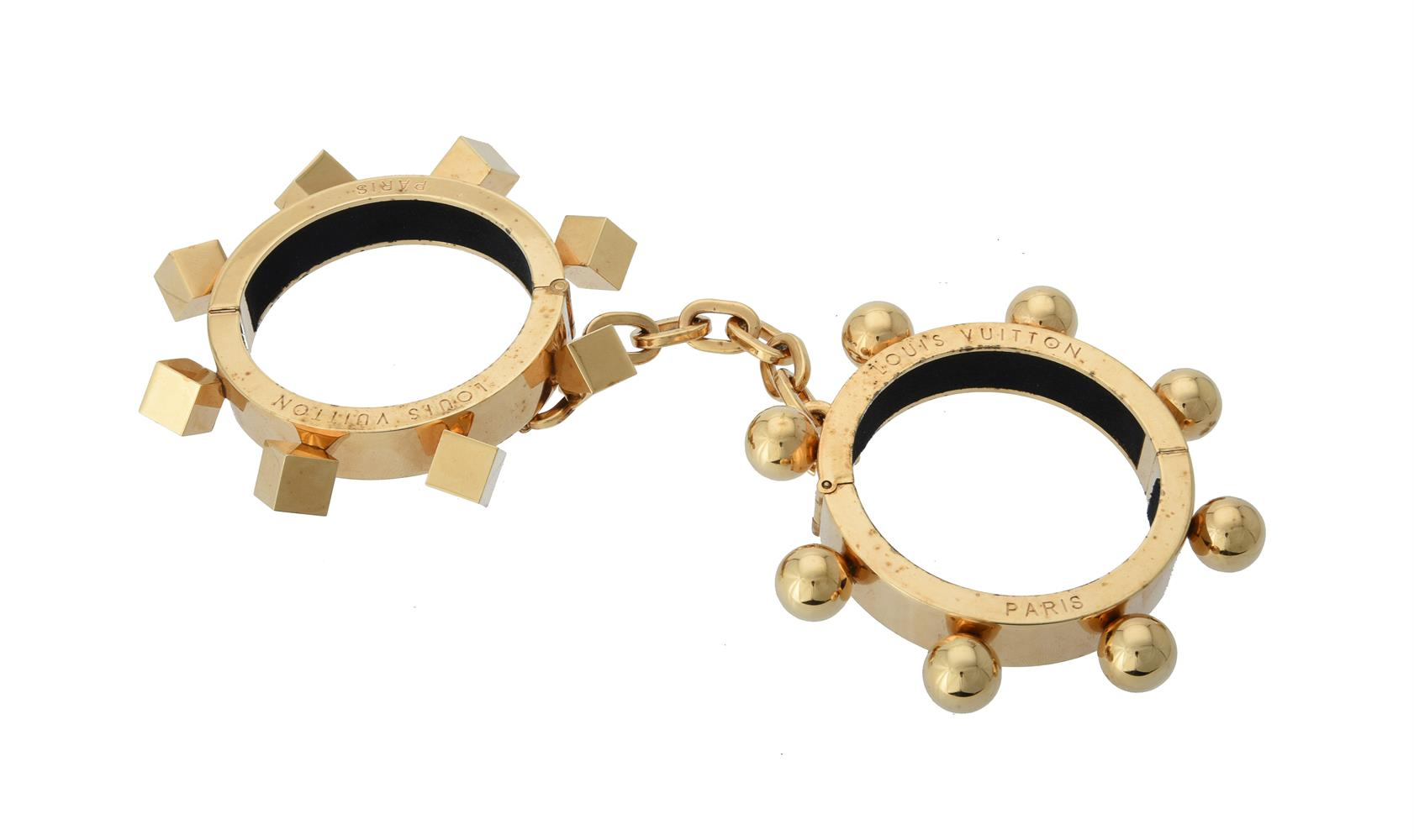Louis Vuitton, a pair of gold plated handcuff bangles