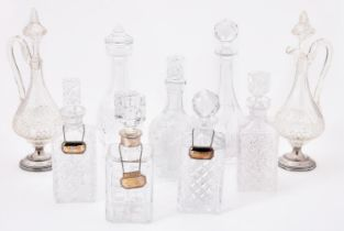 A collection of nine cut glass decanters