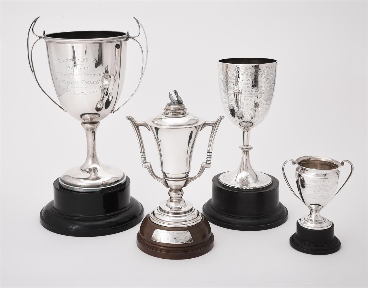 A silver twin handled trophy cup and cover by Boodle & Dunthorne