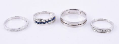 An 18 carat gold diamond band ring