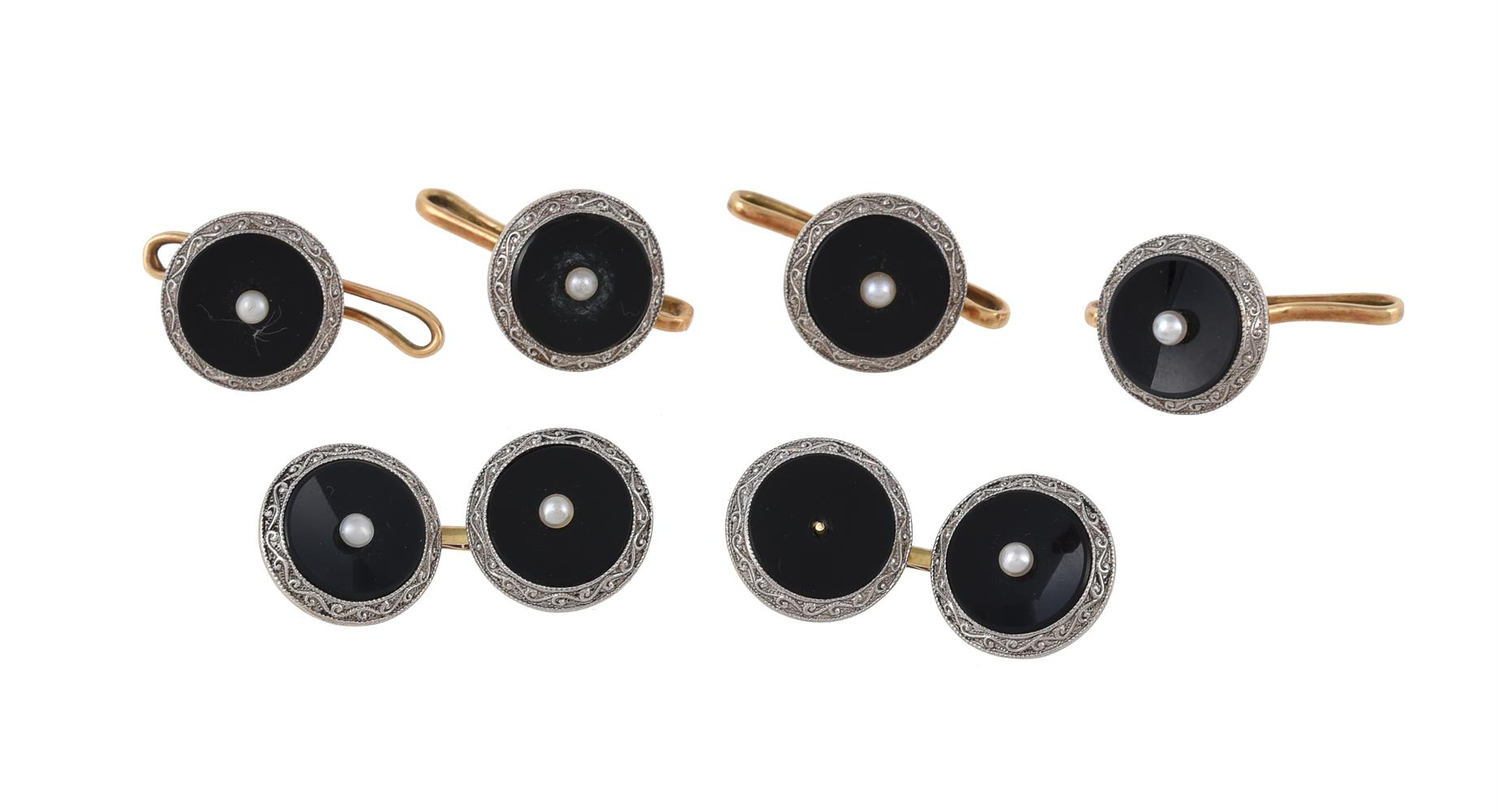 A pair of 1930s onyx and seed pearl cufflinks