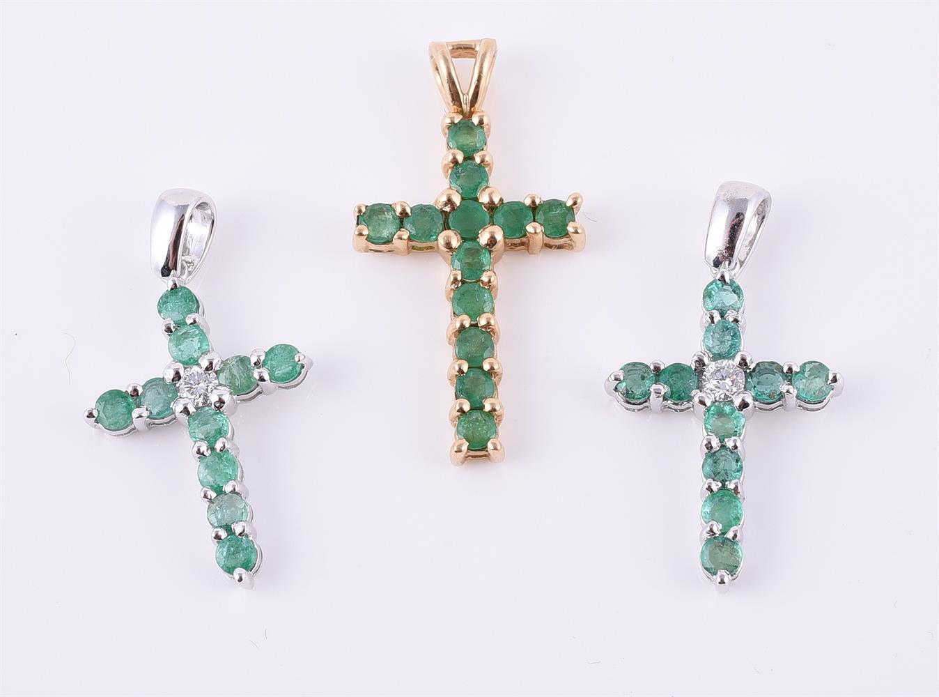 Two emerald and diamond crosses