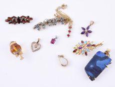 A collection of various gem set pendants