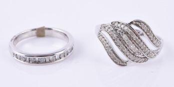 A white gold diamond band ring
