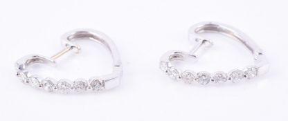 A pair of diamond heart shaped ear hoops