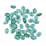 † A parcel of oval cut emeralds