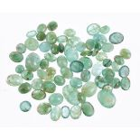 † A packet of unmounted oval cabochon emeralds