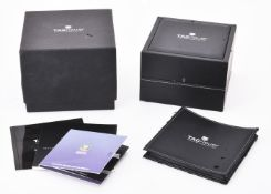Tag Heuer, a black leather watch box