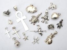 A collection of silver coloured pendants