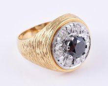 A diamond and black diamond cluster dress ring