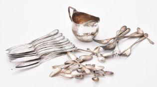 A George III silver oval baluster cream jug