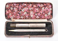 A silver cased fountain pen