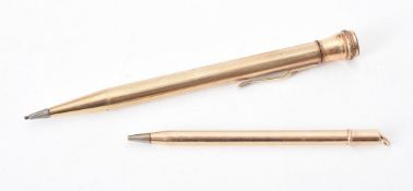 A gold coloured propelling pencil