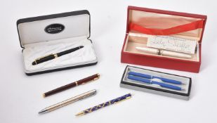 A collection of assorted pens