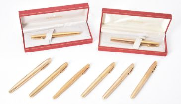 Sheaffer, a collection of eight gold plated pens