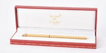 Must de Cartier, Trinity, a gold plated fountain pen