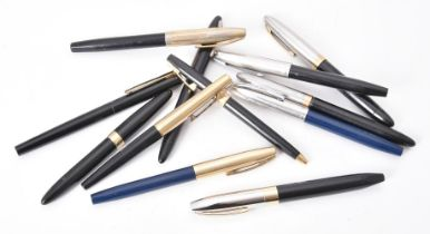 Sheaffer, a collection of eleven fountain pens and a ballpoint pen