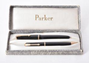 A collection of black Parker pens