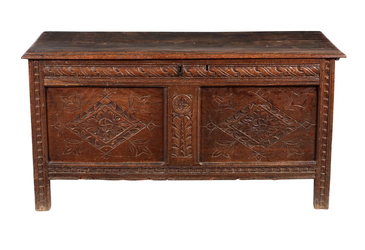 A carved oak coffer