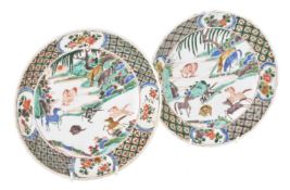 A pair of Chinese famille verte 'eight horses' plates