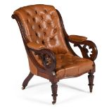 An early Victorian mahogany and buttoned leather upholstered library armchair