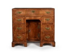 A George II walnut and feather banded kneehole desk