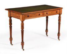 A Victorian walnut writing table