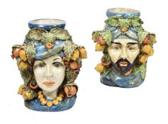 A pair of modern Sicilian Maiolica style figural head jars or planters