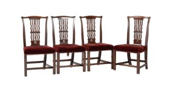 A set of four George III mahogany dining chairs