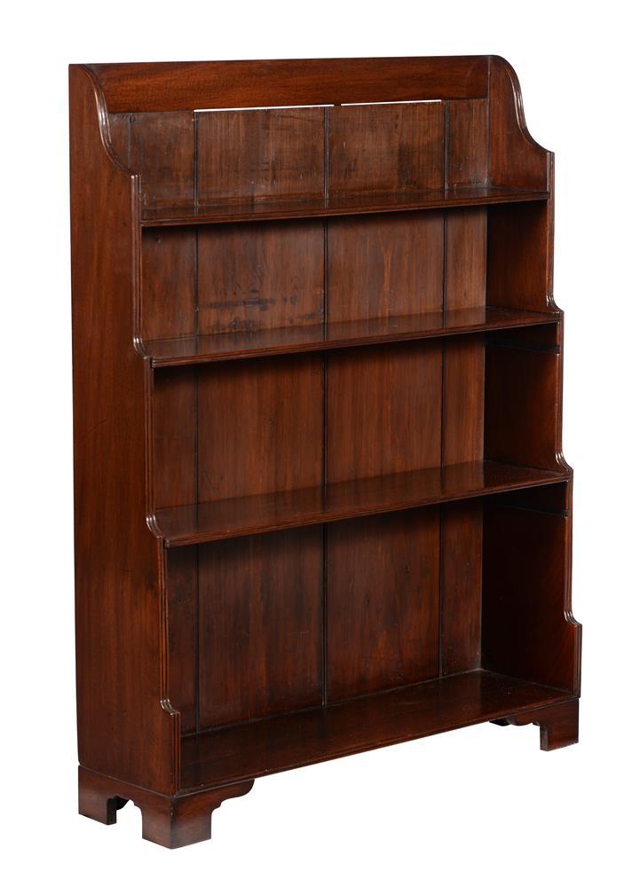 A mahogany waterfall bookcase