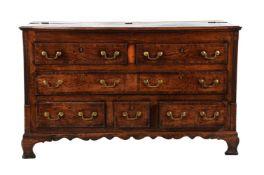 A George III oak and mahogany crossbanded mule chest
