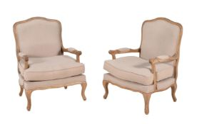 A pair of oak and upholstered armchairs in Louis XV style