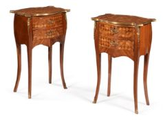 A pair of French parquetry bedside tables