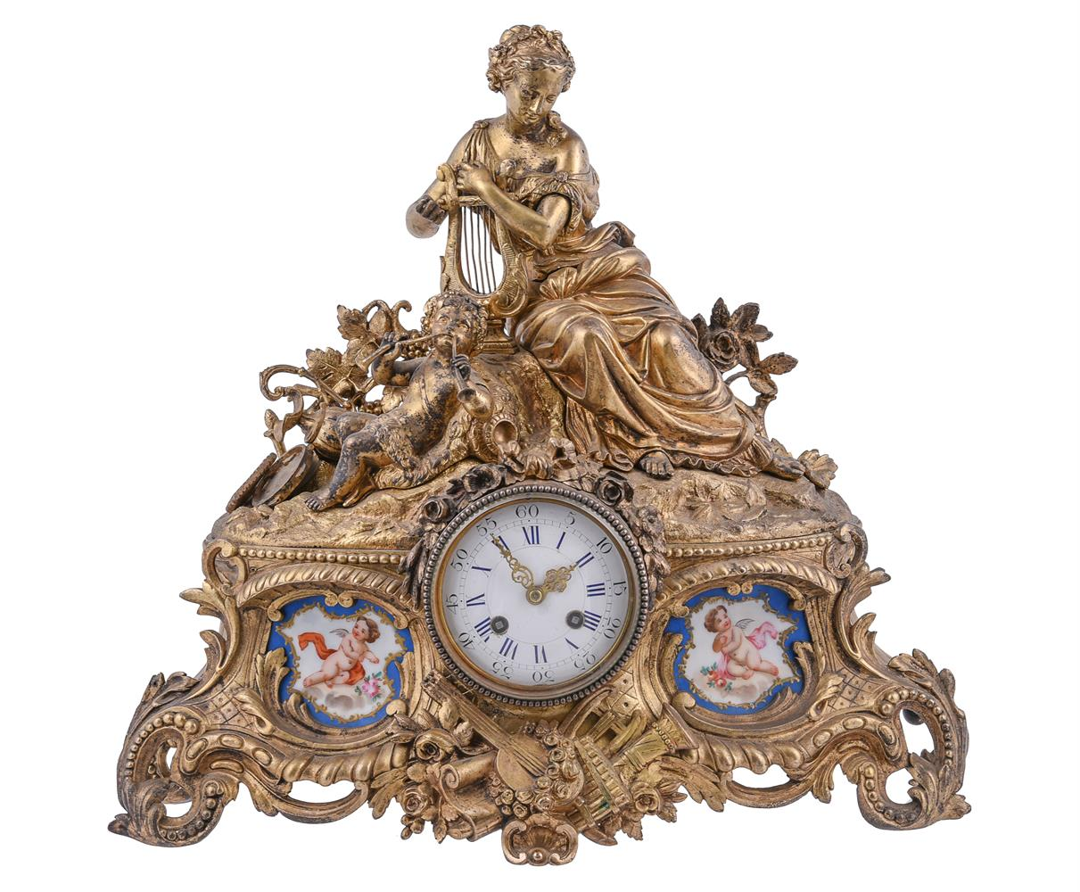 A French giltmetal and Sevres-style porcelain inset mantel clock