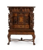 A carved walnut cabinet