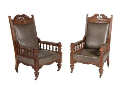 A pair of Victorian carved oak and upholstered armchairs