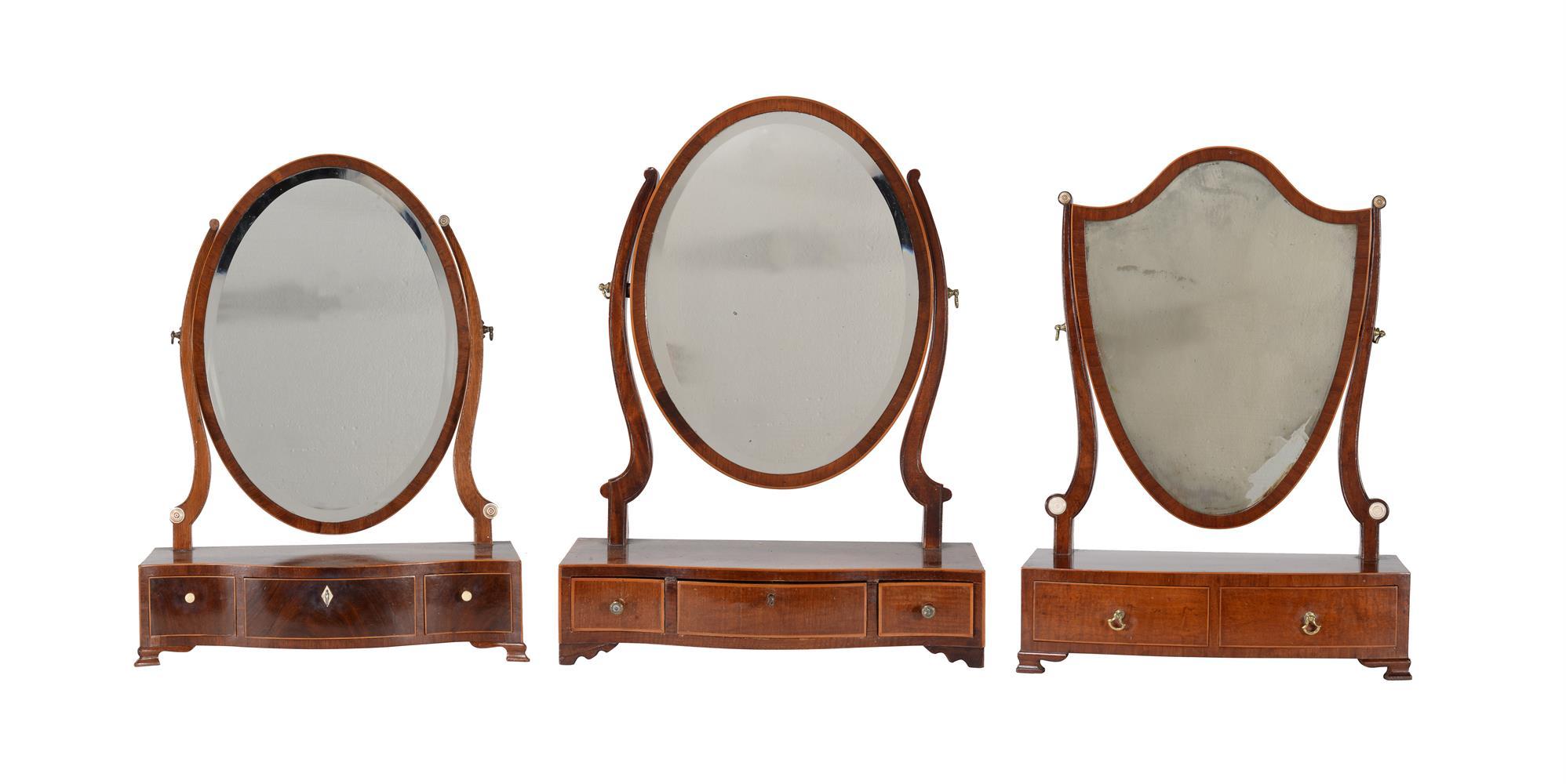 A group of three similar George III mahogany platform dressing mirrors