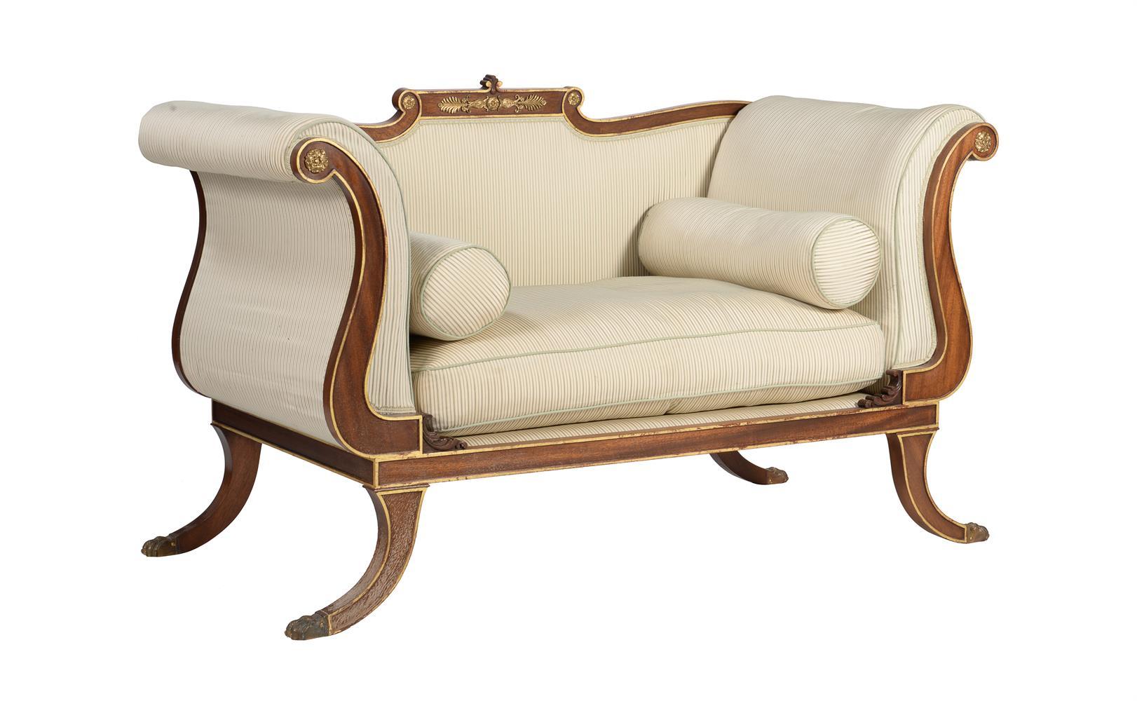 A mahogany and parcel gilt sofa